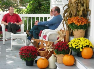 Rabbit Hill Inn Assistant Innkeeper, Donn, talks to guests on the porch.