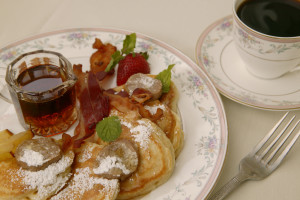 Apple Dollar Pancakes on a plate with syrup from Captain's House Inn