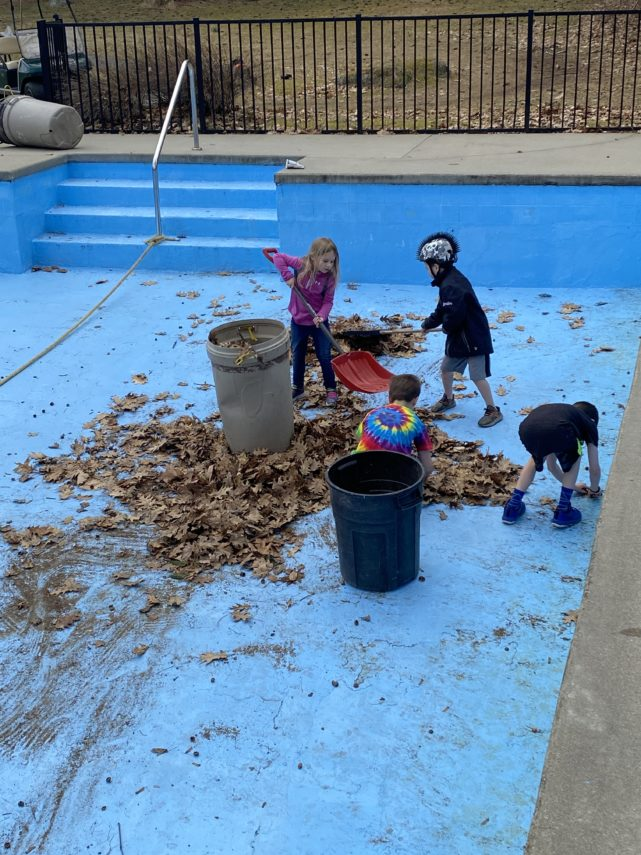 Grandchildren help clean pool at Manor on Golden Pond