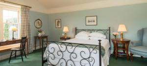Bright and cheerful bedroom with a unique ornate green bedstead.