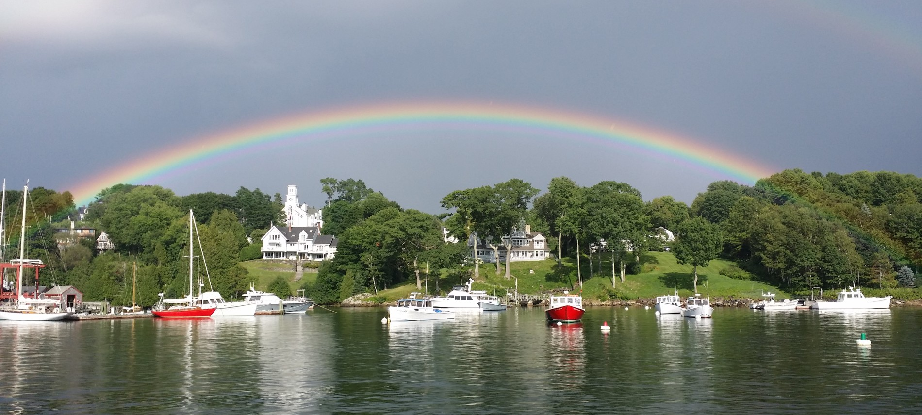 A rainbow forms over Rockport, Maine