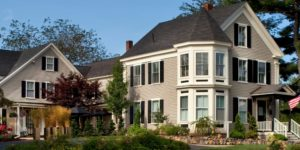 2 story English Meadows inn in Spring with green grass