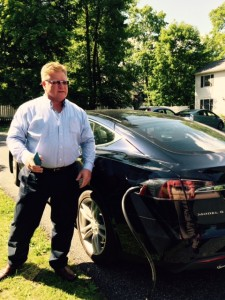 Tesla owner charges car at Gateways Inn