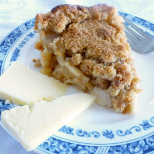 Photo of Apple Pie on a blue and white plate with Cheddar Crust from Grafton Inn