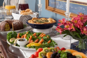 Expansive breakfast buffet including salmon, quiche, fresh fruit, coffee cake and juices.