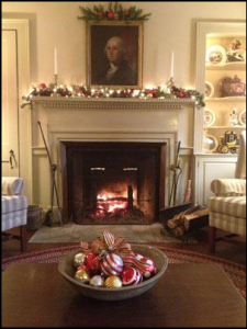Photo of fireplace with fire and mantle decorated for holidays at Grafton Inn