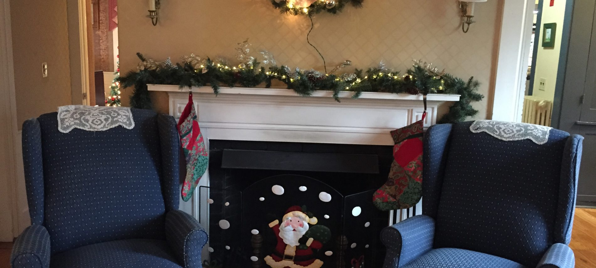 Holiday mantle and 2 chairs at Captain's House Inn
