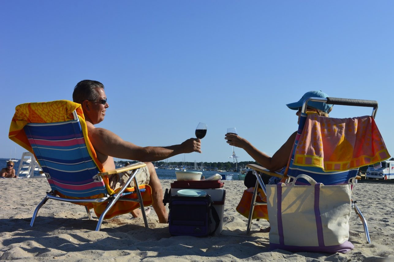 toasting at the beach near Inn at Harbor Hill Marina