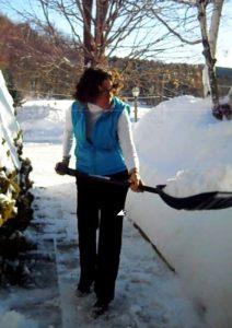 Chesterfield Inn's innkeeper, Judy, shoveling