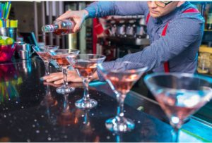 Red martinis prepared at the bar
