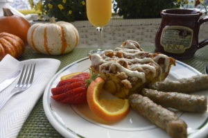 Photo shows Pumpkin French Toast, sausage, and orange slices on a plate at Inn at Harbor Hill Marina.
