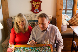 Couple enjoying puzzle at Rabbit Hill Inn