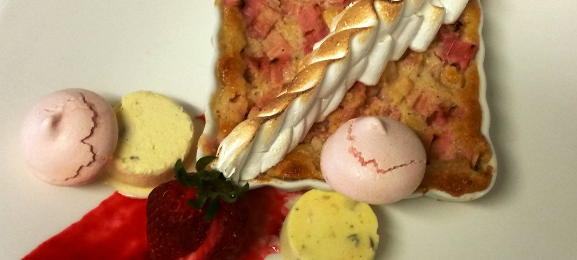 Photo of rhubarb custard with maringue and cookies from Rabbit Hill Inn