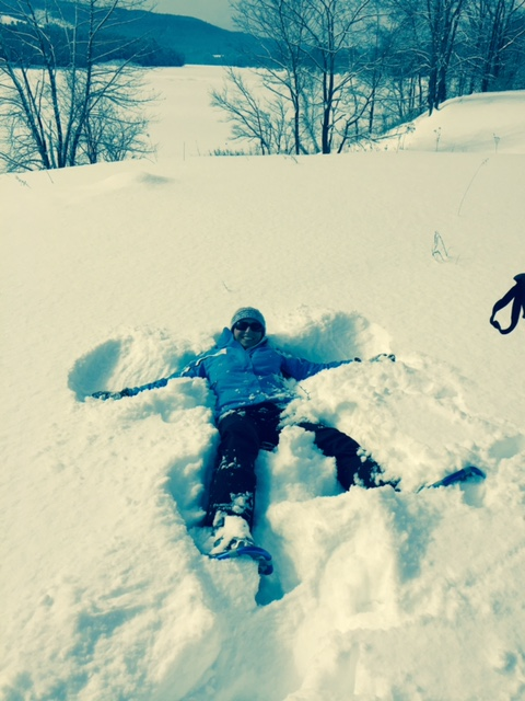 Guests create snow angles in the snow at Rabbit Hill Inn