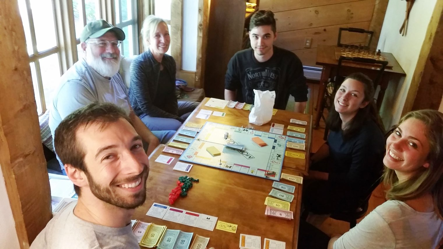 Guests play board games in the Snooty Fox Pub at Rabbit Hill Inn