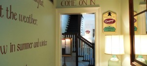 Foyer of inn with wording painted on the walls.